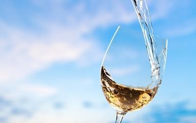 White wine splash isolated on background
