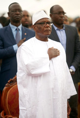 Ibrahim Boubacar Keita, President of Mali and candidate of Rally for Mali party (RPM), stands as he listens to the national anthem during a rally, ahead of the second round of Mali's presidential election, in Bamako