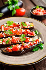 Baked eggplants with tomatoes, onion and garlic