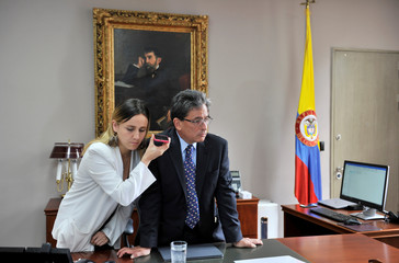 Colombia's Finance Minister Alberto Carrasquilla Barrera attends a call in his office, in Bogota