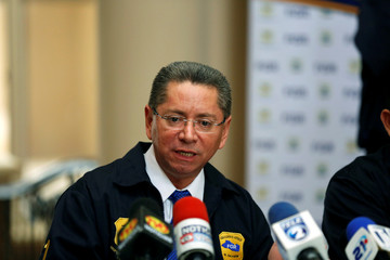 Attorney General Douglas Melendez takes part in a news conference a house of El Salvador's former President Elias Antonio Saca seized by the Attorney General's Office in San Salvador