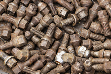 Used old oily wheel bolts, wheel nuts, texture background