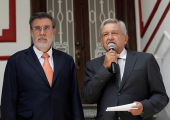 Mexico's incoming President Andres Manuel Lopez Obrador speaks next to his legal adviser Julio Scherer, during a news conference, in Mexico City