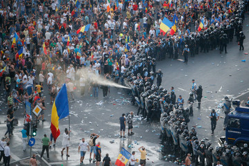 Police use pepper spray during a demonstration in Bucharest