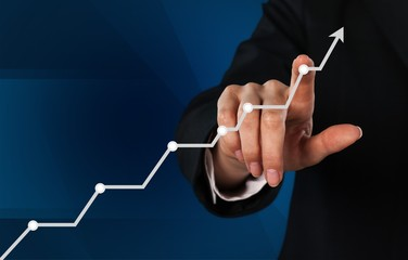 Businessman and  growing line ,symbolize growing