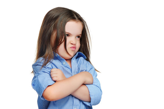 Pouted girl with crossed hands looking to the side