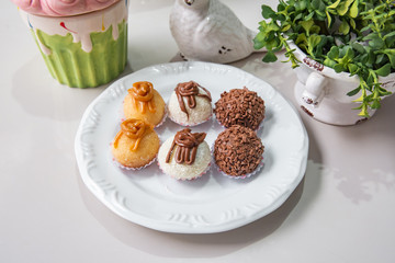 Brigadeiro Traditional brazilian sweet - brigadier - With plate and white background on a decorated table