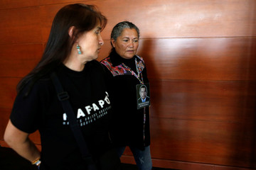"Members of the human rights group ""Mothers of Soacha"" arrive for a hearing in Bogota"
