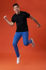 Casual man in air jumping