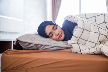 sleeping muslim woman in bed