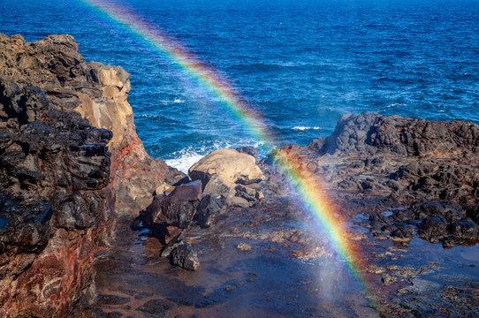 rainbow at ocean blow hole