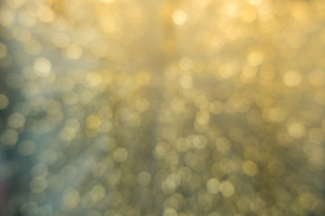 Abstract yellow bokeh circles for Christmas background. Royalty high-quality free stock photo of Christmas light overlay background. Holiday glowing backdrop. Defocused background with blinking stars