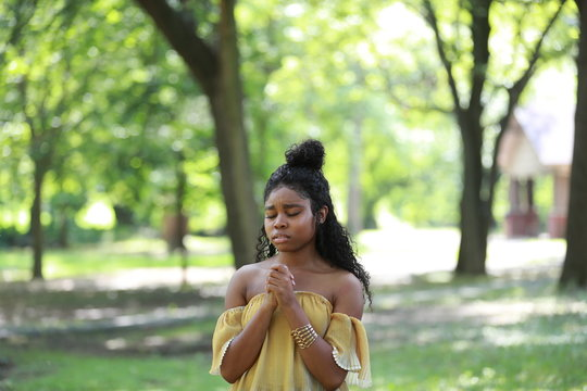Charming upset black woman begging with faith