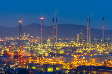 scenic of oil refinery night vuew and mounatin background