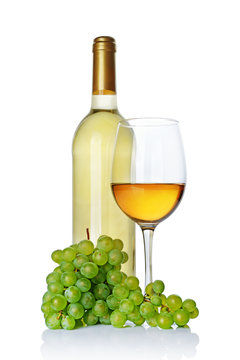 White wine bottle with glass for tasting and fresh grape