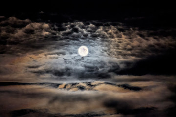 Clear moonlit night. Moon and clouds in the night sky_
