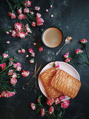 Pink flowers, puff pastries and coffee on a dark background, Bush roses, Blog style, Flatlay, Floral, Postcard
