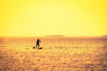 Stand Up Paddle Boarder at sea. Photo from Oulu, Finland.