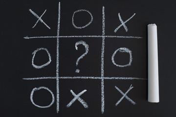 O X Game on black chalk board