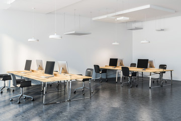Wooden tables in modern company office