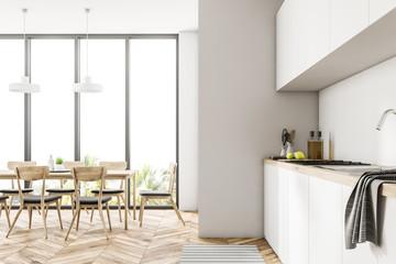 Modern white loft dining room and kitchen