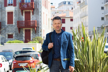 Handsome man. Outdoor male portrait. Middle-aged man, street photo, Biarritz, France.