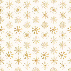 Golden Christmas pattern with creative hand drawn snowflakes. Vintage decorative design.