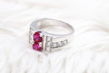 Pink gem stone on diamond ring