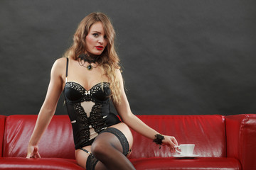Woman wearing sexy lingerie having coffee cup