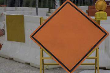 Blank orange diamond-shaped construction warming sign