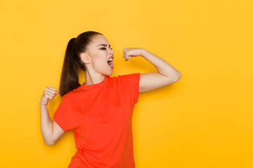 Young Woman Is Flexing Muscles And Shouting
