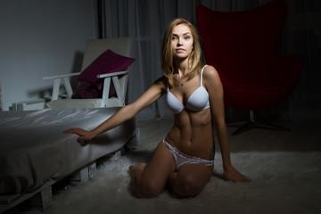 Girl In Lingerie In A Dark Room