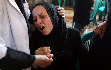 Relative of Palestinian medic Abdullah Al-Kotati, who was killed while trying to help wounded protesters at the Israel-Gaza border, mourns during his funeral in Rafah in the southern Gaza Strip