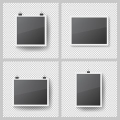 Realistic blank photo frames set on transparent background. Template picture frame hanging on binder clips. Isolated vector framework with shadow on the wall. Black empty place for presentation