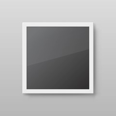 Realistic square picture frame isolated on grey wall. Mockup photo frame with white border and black empty place. Blank vector template with shadow effect for artwork exhibition or interior decoration