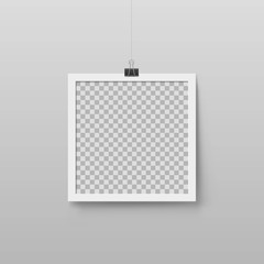 Realistic blank photo frame hanging on binder clip. Layout for art gallery design. Mockup picture frame with white border. Transparent empty place for artwork. Interior decoration vector element