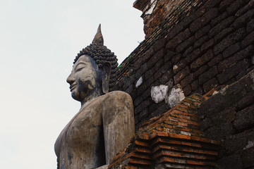 Buddha statue at Wat Sri Chum temple is ancient of world heritage Sukhothai Historical Park, Sukhothai province, Thailand
