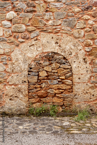 Bricked Up And Blocked Doorway In An Old Stone Building With Arch Over Door  Frame