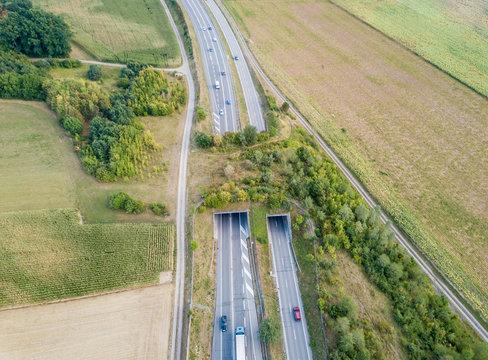 Aerial view of wildlife overpass over highway in Switzerland during sunset