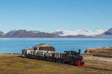 Acrylic Prints Arctic old industrial train in Ny Alesund, Spitzbergen, Svalbard, blue sky