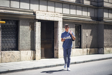 Young and modern business man crossing the street