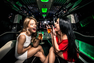 Girls partying in a limousine