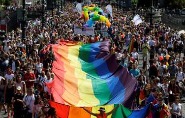 Participants hold a giant rainbow flag during the Prague Pride Parade