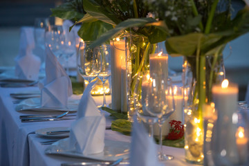 Wedding Banquet or gala dinner decorated with garlands. Festive Luxury table set up decor for wedding, party, event