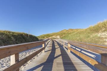 Wooden Boardwalk at Sylt-Wenningstedt at Sunset / Germany