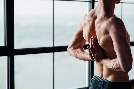 healthy back and spine. effective yoga training. sport and fitness. man exercising asana in gym.
