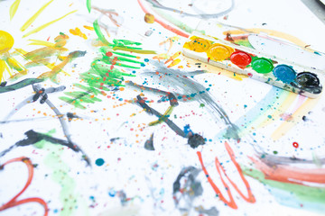 Children's drawing in colorful colors. Close, top view. Children's entertainment, family leisure