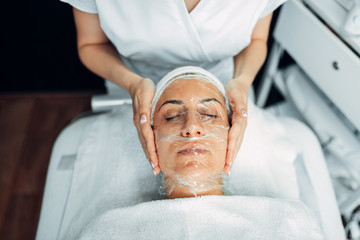 Doctor makes face mask, getting rid of wrinkles