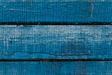 colorfull old painted horizontal wooden plank with crack and scratches background
