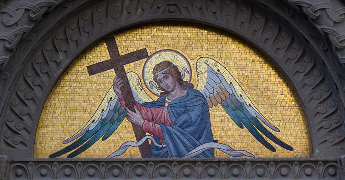 """Milano, Italy. 2018/2/8. A mosaic of an angel holding a cross on a tomb at the Cimitero Monumentale (""""Monumental Cemetery"""") in Milan, Italy."""